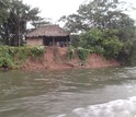 A family home on a low bluff above an Amazonian river.