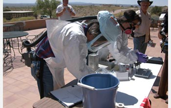 Photo showing biologists collecting blood samples from rodents to test for Hantavirus.
