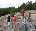 Photo of undergraduate and graduate students scoping out the landscape on a field trip.
