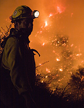 Photo of a firefighter fighting a wildfire