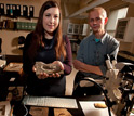 Lauren Sallan and Michael Coates handle an actinopterygian fossil in their lab.