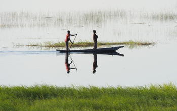 Fishermen on Botswana's Chobe River, site of the study of floodwaters and disease.
