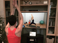 woman exercising in front of monitor