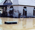 Photo of a house inundated by flooding.