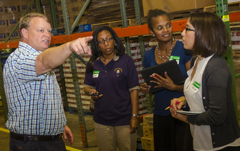 Researchers visit a food bank.
