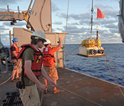 Deployment of an ocean bottom seismograph from the research vessel Thompson.