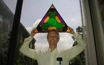 Frank Morgan holding stained glass reproduction