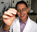 Benny Freeman of The University of Texas at Austin holds a sample of the new membrane.