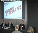 Image of Popular Mechanics automotive editor Larry Webster with discussion panel.