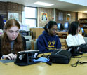Photo of students using  digital game-based learned on computers.