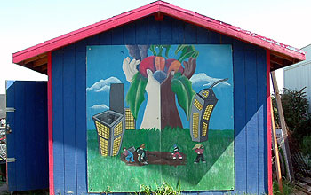 Colorful toolshed mural inside garden.