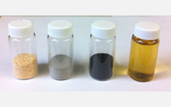Vials containing sawdust, catalyst, charred catalyst and gasoline made from sawdust.