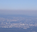 Haze obscures many urban areas, like Frankfurt, Germany.