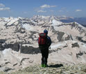 Photo of researcher viewing snow-capped mountains.