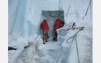 Photo of two people excavating a sampling tunnel into Taylor Glacier.