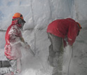 Shawn Doyle (left) and Tim Brox use chainsaws to excavate sampling chamber inside Taylor Glacier.