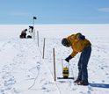 Photo of researchers collecting radar data to document meltwater movement on the Ice Sheet.