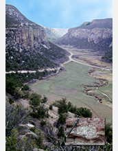 Photo of Unaweep Canyon in the Rockies , the site of a deep gorge. Inset shows a dropstone.