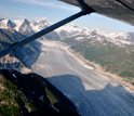 Aerial photo showing streams of melting ice covering the surface of a glacier.