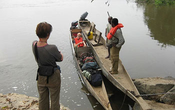 Students with equipment and boats on the Ogoou� river in Gabon