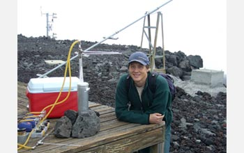 Photo of David Noone by a vapor-collecting cryospheric trap near the Mauna Loa Observatory.