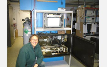 Photo of David Noone next to Charles Keeling's original CO2-monitoring equipment.