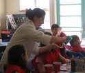 Photo of Susannah Gordon-Messer demonstrating how to make slime.