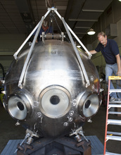 Two technicians working on the new Alvin personnel sphere