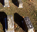 Photo of graves in a graveyard.