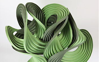 Photo of curve-crease sculpture called Green Balance, created by Erik and Martin Demaine.