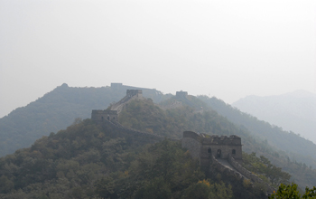 Photo of Great Wall of China near Beijing obscured by air pollution, dust and sand.