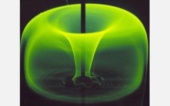 "A fluorescent dye injected into a tank of stirred liquid creates a ""green apple"" pattern."