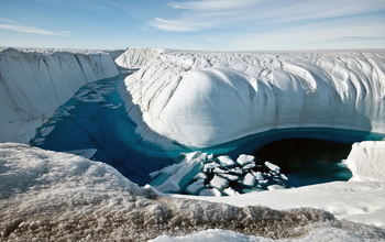 A Greenland ice canyon filled with meltwater in summer 2010.