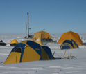 Photo of tents and the drilling rig in Greenland.
