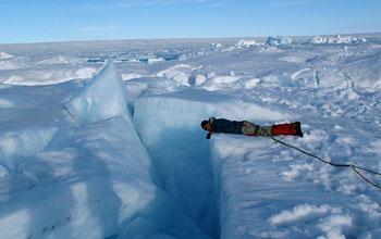 Researcher near a crevasse on the Greenland ice sheet.