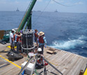 Scientists collecting water samples from the Gulf of Mexico.