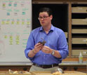 Neil Roach talking in a lab