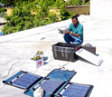 Louis Obenson of Haiti's Civil Protection Agency installs GPS equipment in Port-au-Prince.