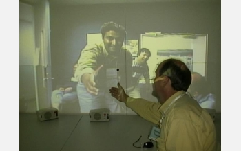Office of the future: a virtual handshake using sophisticated computer graphics.