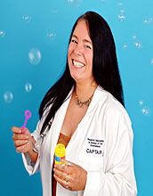 Robyn Hannigan in labcoat with bubbles