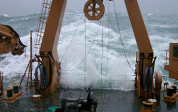 Photo of waves breaking over the fantail of the Healy.