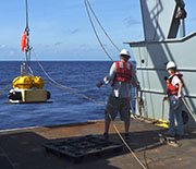 Ocean bottom seismograph deployment from the research vessel Thompson.