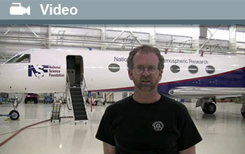 Bruce Daube standing in front of NSF's Gulfstream V aircraft with word Video and video icon.