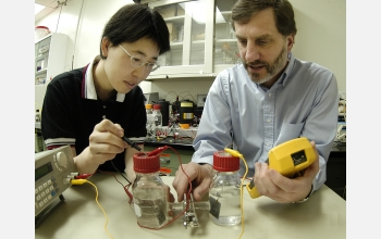Hong Liu (left) and Bruce Logan examine an electrochemically assisted microbial reactor system