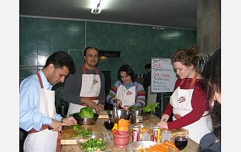 Students at the Petra workshop prepare a traditional Jordanian dinner.