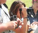 Students with binoculars at horned toad camp in Oklahoma