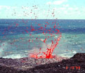 Photo showing lava splattering near the coastal entry of Kilauea.