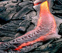 Photo of smooth, unbroken pahoehoe at Kilauea.