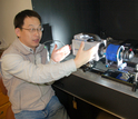 Scientist Houshuo Jiang with the new video system he developed.