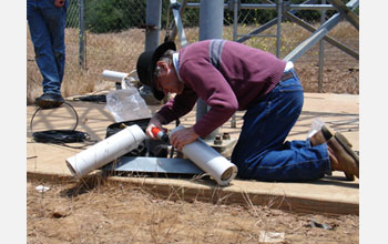 Photo of Hans-Werner Braun assembling and placing a technology on the network.